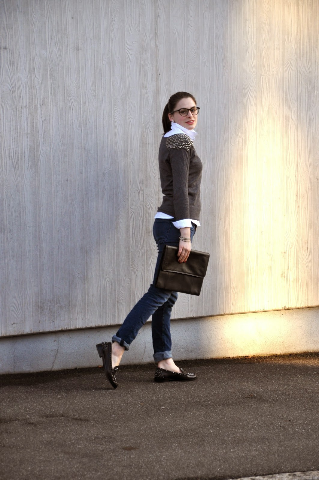 studded loafers, pullover, white blouse, black clutch