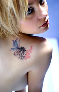 Tattooed Female with a Fairy Angle Tattoo on Upper Back