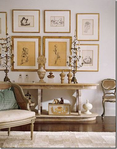 white gallery walls living room gold accents