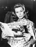 Samantha Stephens (Elizabeth Montgomery) reads her adventures in BEWITCHED .