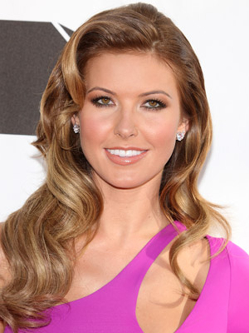Audrina Patridge does retro with sultry, side-parted waves hairstyles and a super-shiny finish.