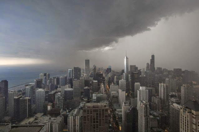 A thunderstorm with heavy rains approaches downtown Chicago, Monday, June 24, 2013. (Credit: AP Photo / Scott Eisen) Click to enlarge.