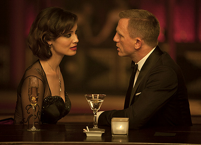 Daniel Craig as James Bond talking with Berenice Marlohe in Skyfall movieloversreviews.blogspot.com