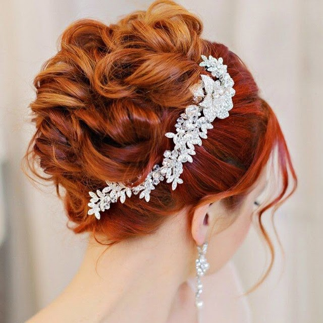 http://cassandralynne.com/products/crystal-bridal-hair-comb-in-a-rhinestone-vine-design