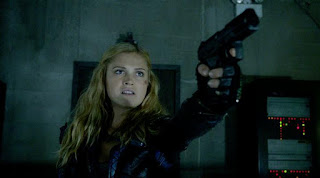 Clarke holding someone at gunpoint