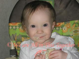 Baby girl cake mess