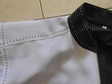 kolar dan jahitan jaket putih