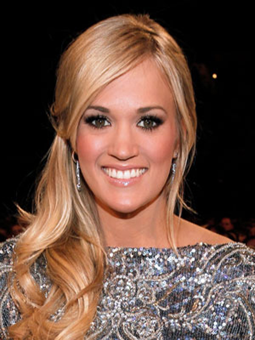 Carrie Underwood's smooth waves and half-up hairstyle go perfectly with her sequin dress.