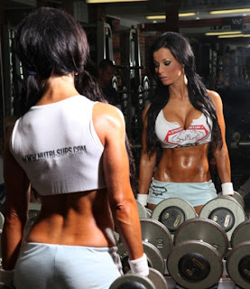 Christina Halkiopouolos in gym lifting weights