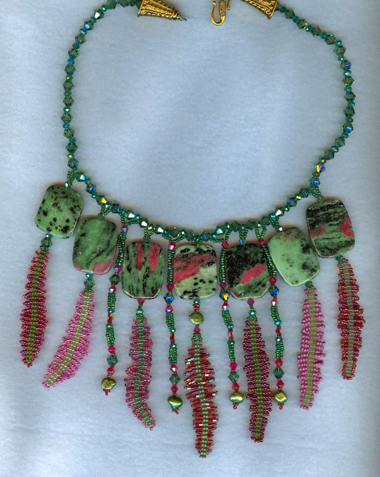 red green ferns with large gem stones