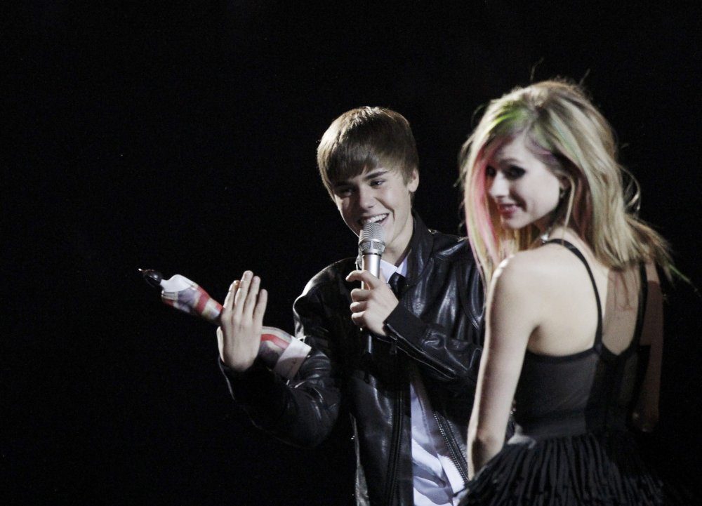 Avril Lavigne and Justin Bieber at 2011 Brit Awards in London