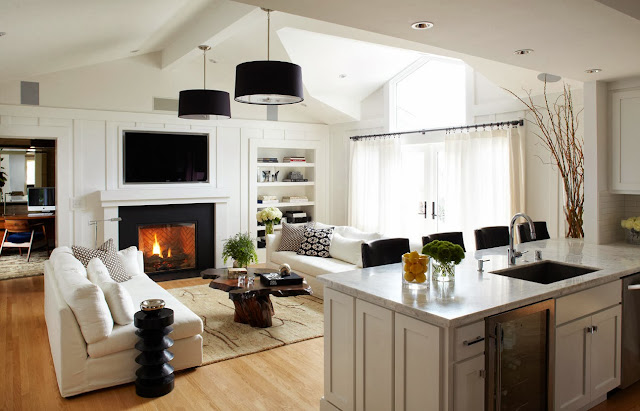 the living room is filled with natural lights and looks gorgeous with its black and white theme
