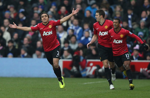 Rafael celebrates with Manchester United teammates after scoring against QPR