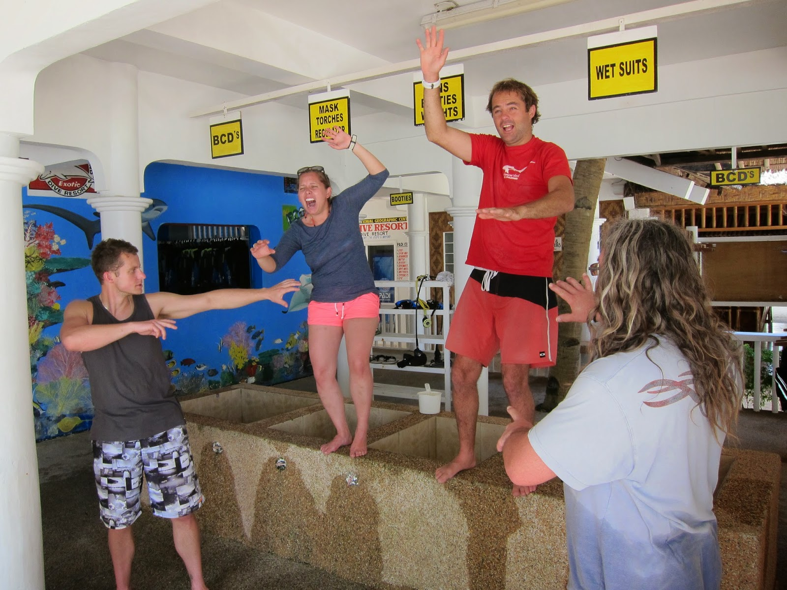 PADI instructors simulating panicking divers on an Exotic Rescue course in Malapascua, Philippines