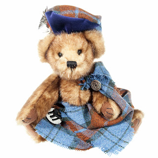teddy bear in light blue tartan plaid kilt