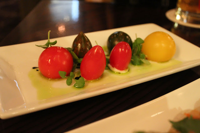 Heirloom tomatoes with Stracchino cheese at Bond, Boston, Mass.