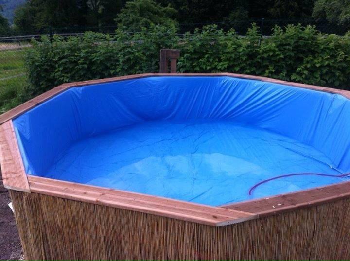 Enorme piscina realizada con palets for Piscina con palets
