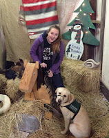 Colleen Bohannan with guide dog puppy at Christmas event