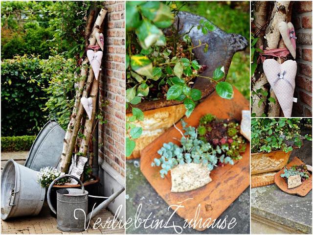 Gartendekoration mit Zinkwannen und Zinkgießkanne