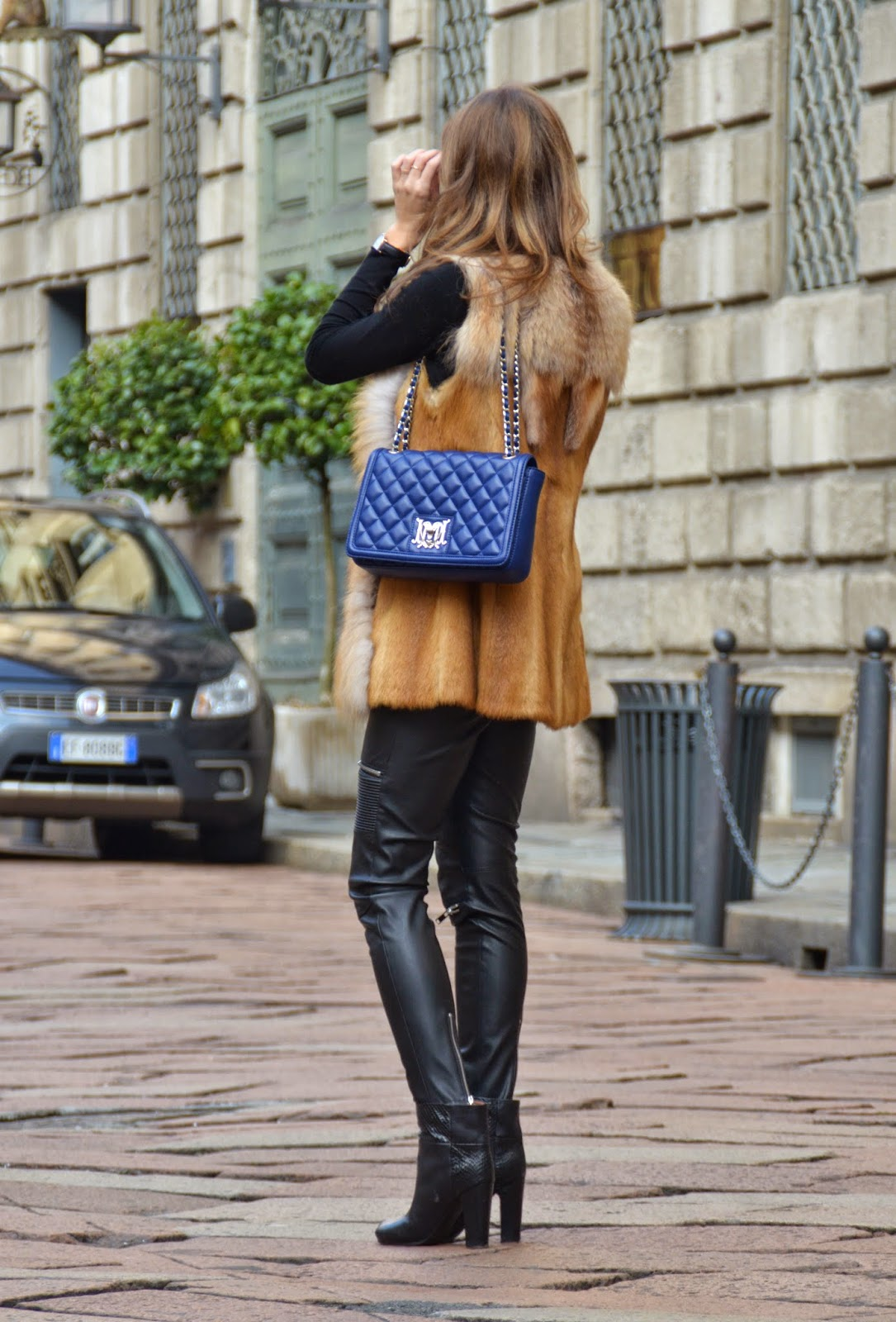 blue-love-moschino-bag-fur-vest-leather-trousers