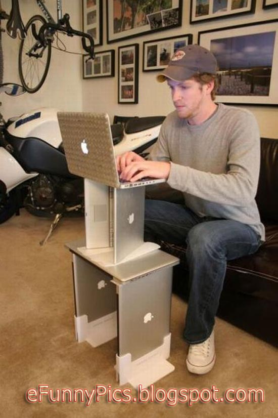 Funny Guy Working on Laptop Table
