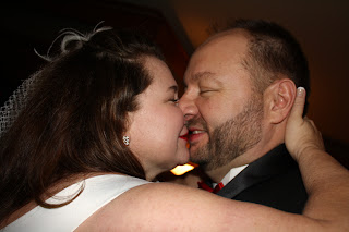 Chris and Charlene exchange their first kiss after their wedding ceremony