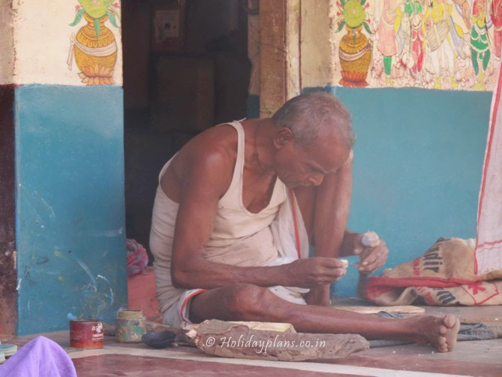 Old man making handicrafts