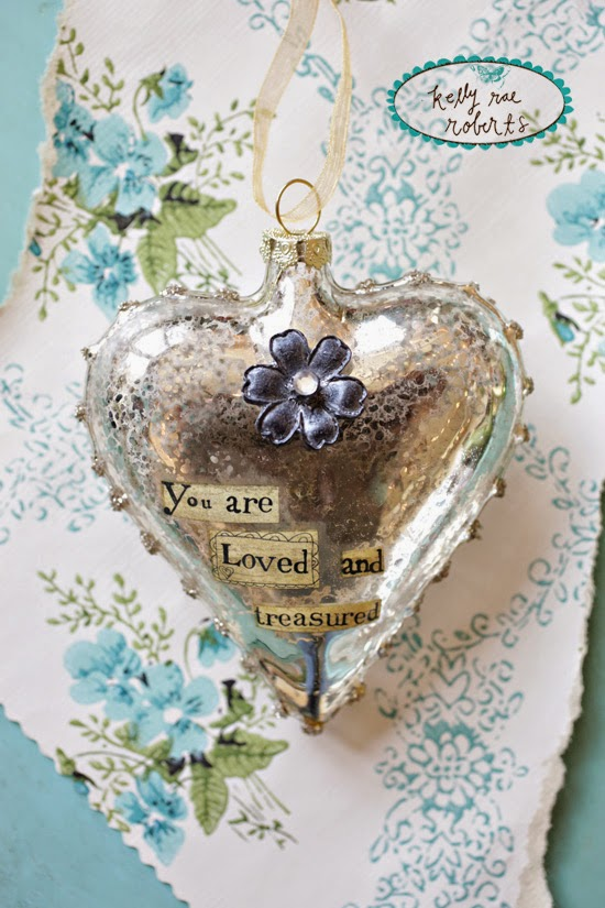 http://gardengalleryironworks.com/collections/2015-kelly-rae-roberts/products/glass-heart-ornament-you-are-loved