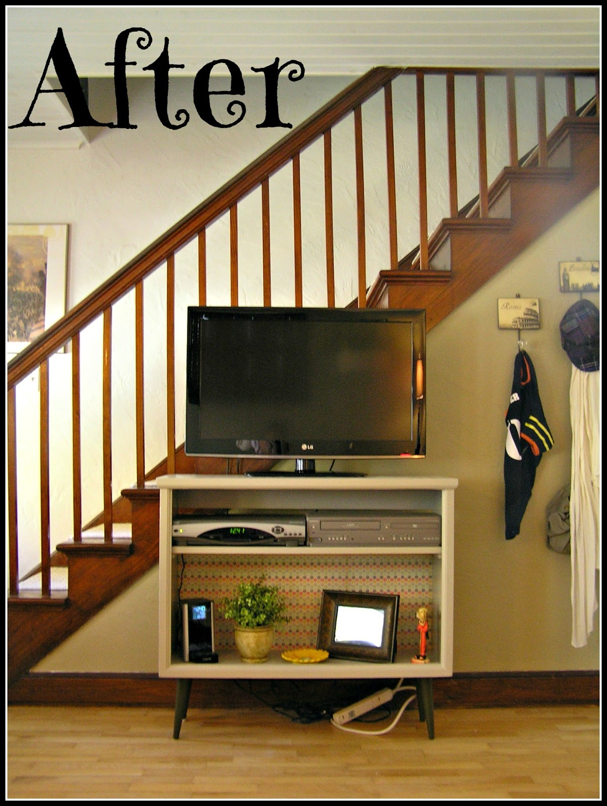 Tasty sweet chronicles of a cupcake artist diy tv stand for Tv showcase designs under staircase