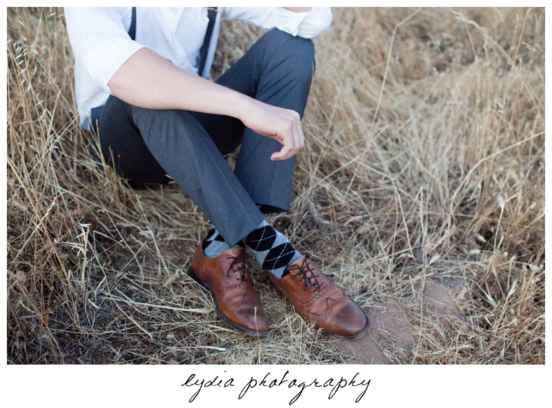 Senior guy's shoes in the hay at Forest Lake Christian senior lifestyle portraits in Rocklin, California