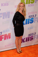 Britney Spears in black dress ands gold heels
