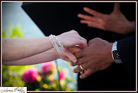 Chris and Karen holding hands - Ceremony officiated by Patricia Stimac, Seattle Wedding Officiant, at the Skansonia Ferry
