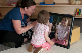NAMC Montessori ams conference brain research teacher and child work with mirror