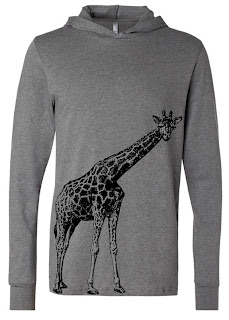 Grayish-tan long-sleeve shirt with hood. There is a realistic drawing of a giraffe in black, silk-screened on. It's hooves are near the hem of the shirt on the left, with its body and neck stretching up and to the right, its head turned to look at you. It takes up about a half or a third of the shirt front.