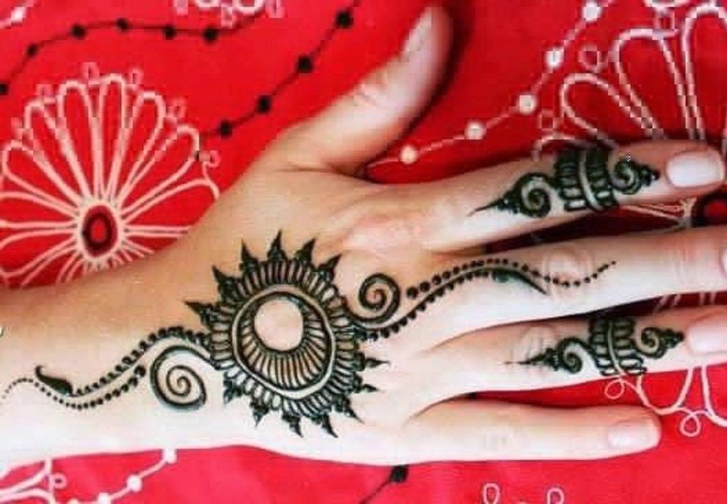 Mehndi Hands Wallpapers : Latest designs of wallpapers. a living room setup featuring salon