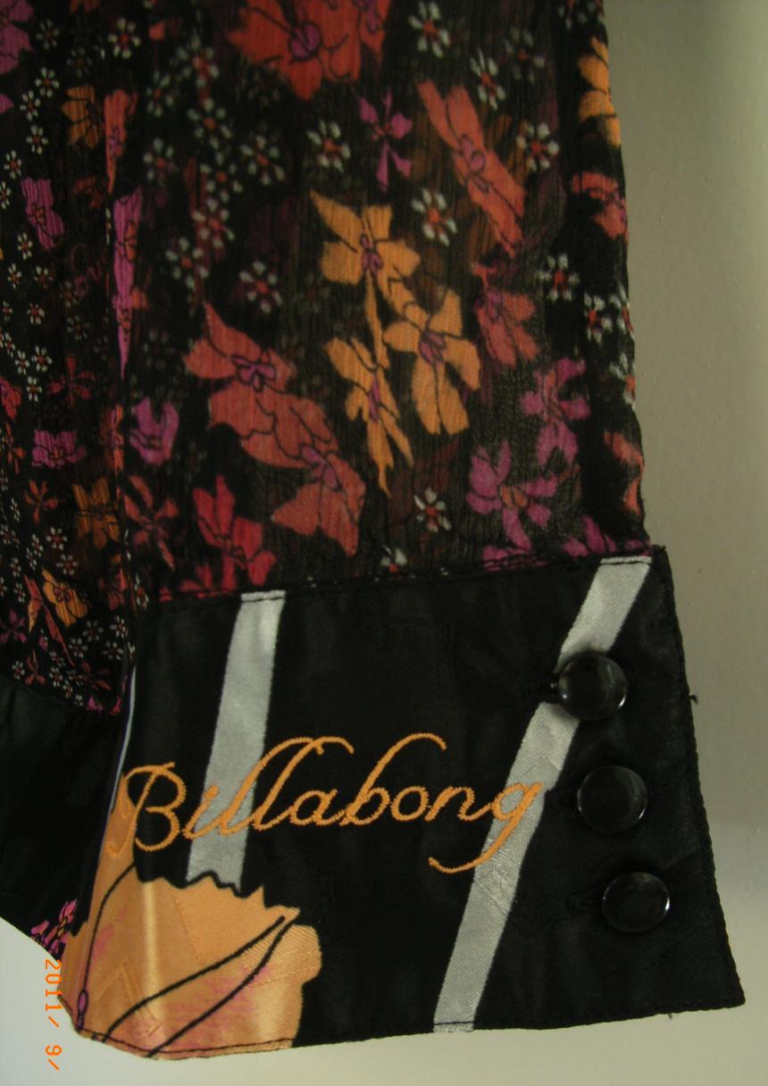 vetement occasion dans vide dressing de Flora : BILLABONG - chemisier noir fleuri