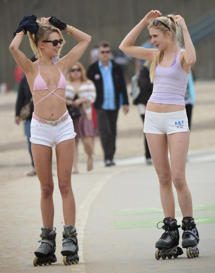 Kimberley Garner plays roller skating in a Pink Bikini with a female friend at Santa Monica on Monday, April 21, 2014