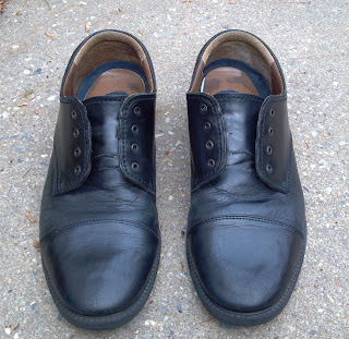fire shined black leather shoes