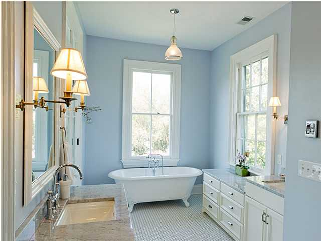 Bathroom with white bathtub by the window