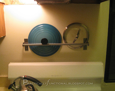 Towel bar to store pot lids