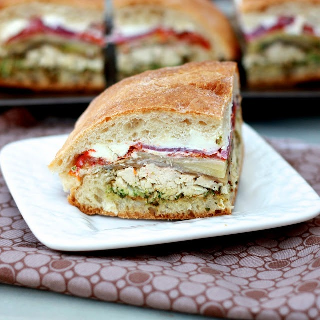 Chicken and Vegetable Pressed Sandwiches with Pesto and Goat Cheese