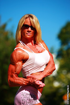 Lisa Giesbrecht bodybuilder flexing biceps