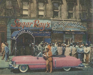 Robinson and his custom pink Cadillac outside his restaurant, 1950s