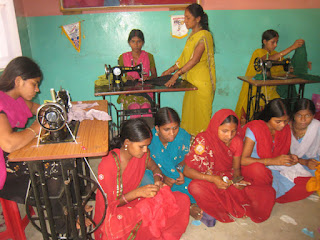 Nine women at the KIRF Sewing Center in India