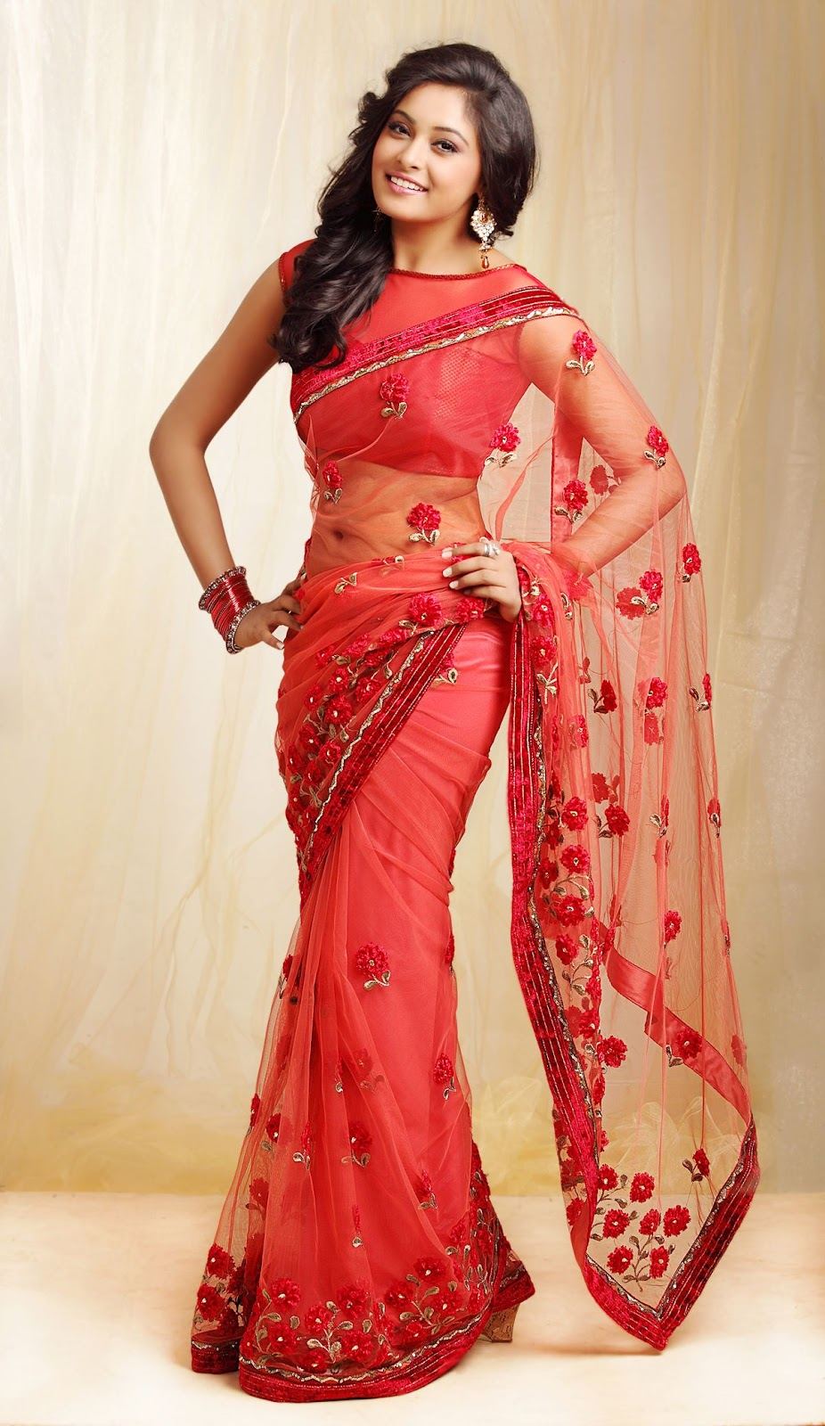 Actress Arundhati In Red Saree With Boat Neck Blouse