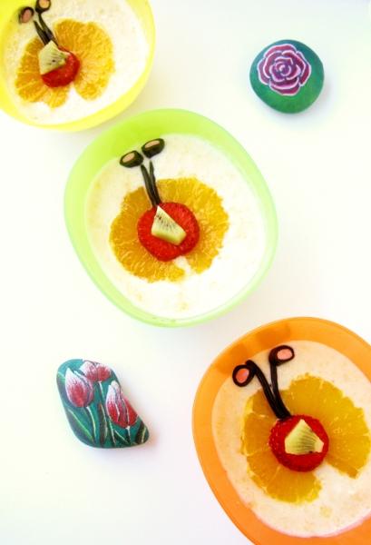 crema di frutta con pere e pesche sciroppate, arancia, kiwi e caramelle