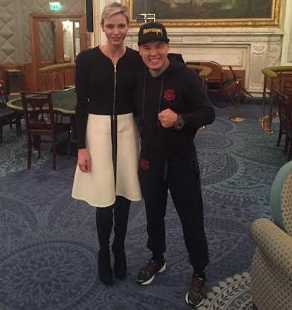 Princess Charlene of Monaco posing with one of the boxers who will take part in tomorrow's tournament in Monaco.