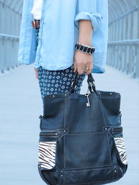 chambray shirt, printed pants, zebra-printed Fossil bag, metal and leather bracelet
