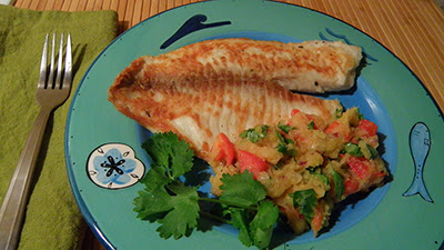 Plate of Fish topped with salsa