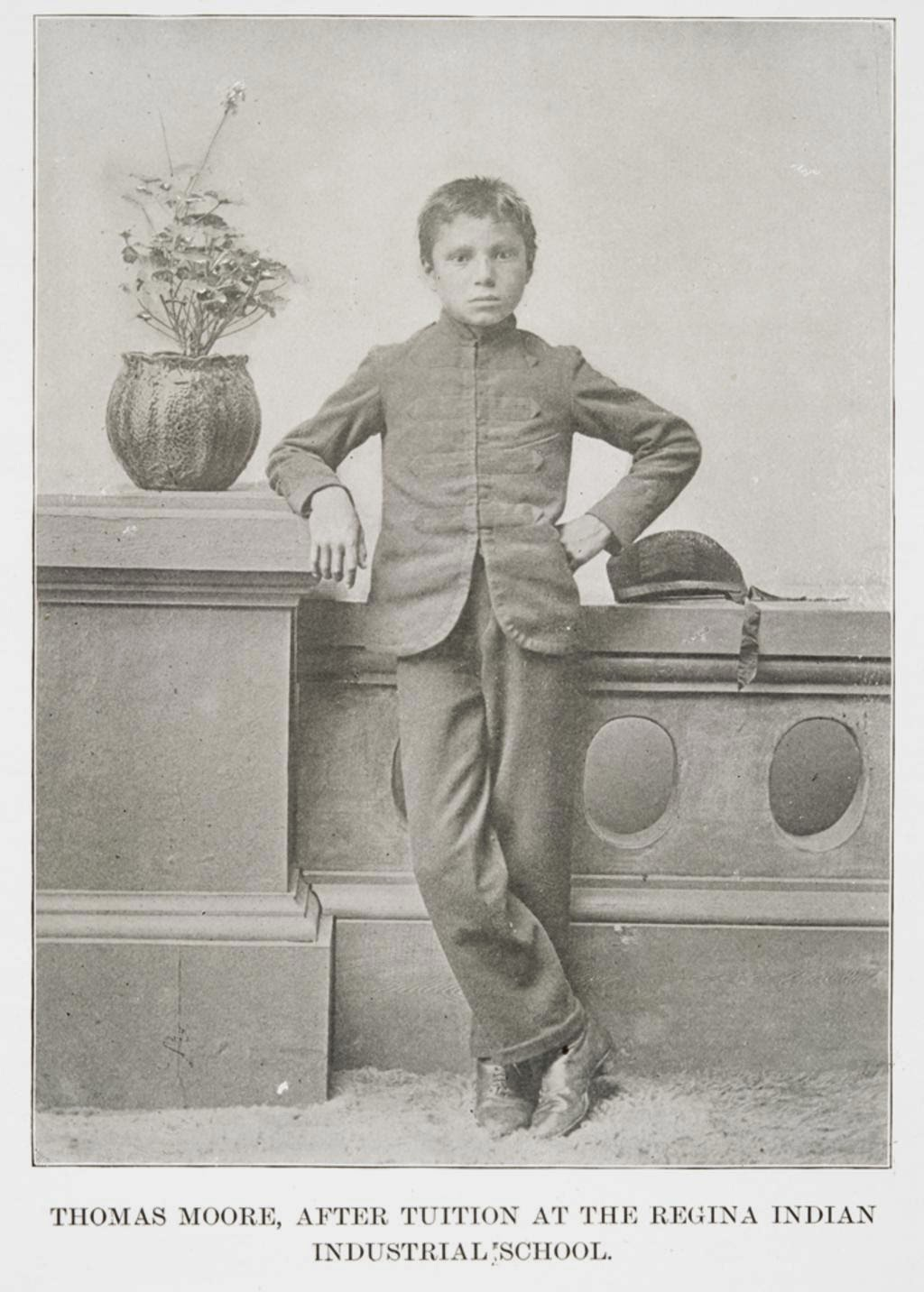 Thomas Moore after entering residential school wearing slacks and jacket.
